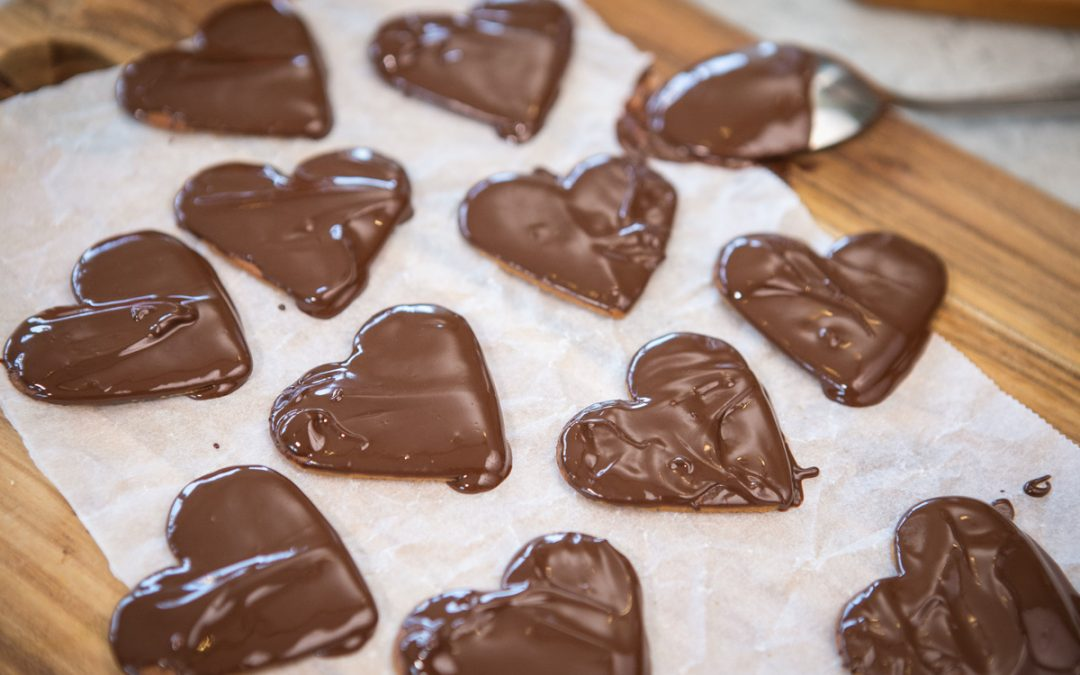 Ginger snaps hearts dipped in chocolate